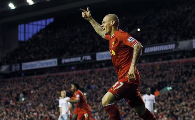 Liverpool's Martin Skrtel celebrates after his team scored during their English Premier League soccer match against West Ham United at Anfield in Liverpool