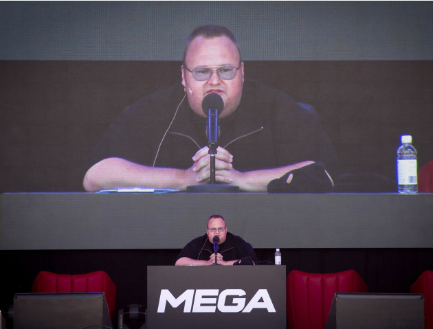 "FILE - In this Jan. 20, 2013 file photo, Megaupload founder Kim Dotcom practices a speech before the launch of a new file-sharing website called ""Mega"" at his Coatesville mansion in Auckland, New Zeal"