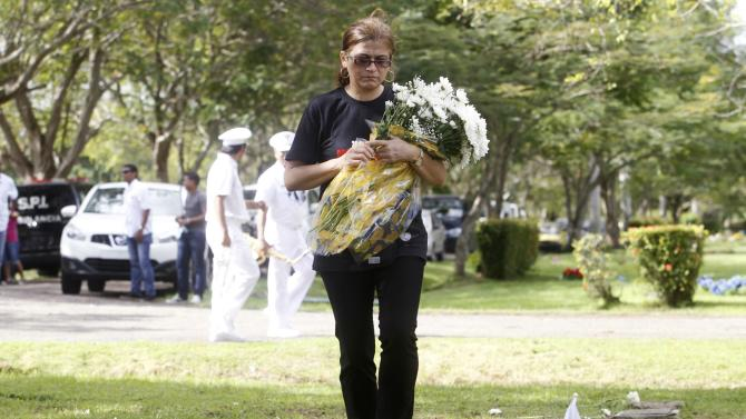 Sonia Perez, family member of a victim of the invasion of Panama, arrives at Jardin de Paz cemetery, during a ceremony in remembrance of the 25th anniversary of the U.S invasion of Panama, in Panama City