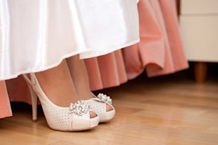 Look slimmer on your wedding day by wearing heels