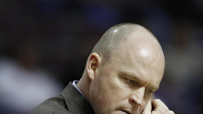 FILE - This Dec. 30, 2012 file photo shows Milwaukee Bucks coach Scott Skiles during a timeout in the fourth quarter of a 96-94 loss to the Detroit Pistons in an NBA basketball game in Auburn Hills, Mich. Skiles is out as Bucks head coach and the team says assistant Jim Boylan will take over for the rest of the season. Bucks general manager John Hammond made it official Tuesday, Jan. 8, 2013 (AP Photo/Duane Burleson, File)