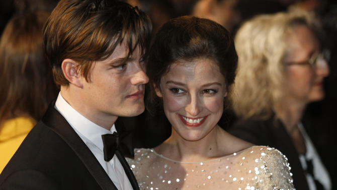 Actors Sam Riley, left, and Alexandra Maria Lara depart following the screening of On the Road at the 65th international film festival, in Cannes, southern France, Wednesday, May 23, 2012. (AP Photo/Lionel Cironneau)
