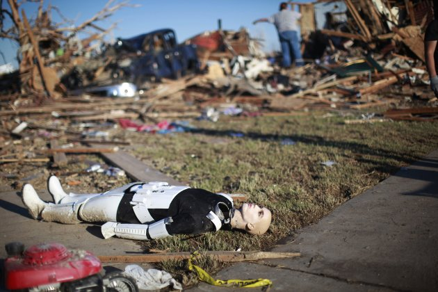 A Star Wars movie character mannequin lies outside a tornado destroyed house in Oklahoma City