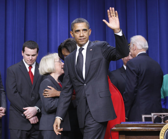 President Barack Obama waves as he walks off stage after signing legislation that will provide tax credits to help put veterans back to work, Monday, Nov. 21, 2011, during a ceremony at the Eisenhower Executive Office Building on the White House complex in Washington. Sen. Patty Murray, D-Wash. talks with first lady Michelle Obama behind the president, Vice President Joe Biden is at right. (AP Photo/Pablo Monsivais)