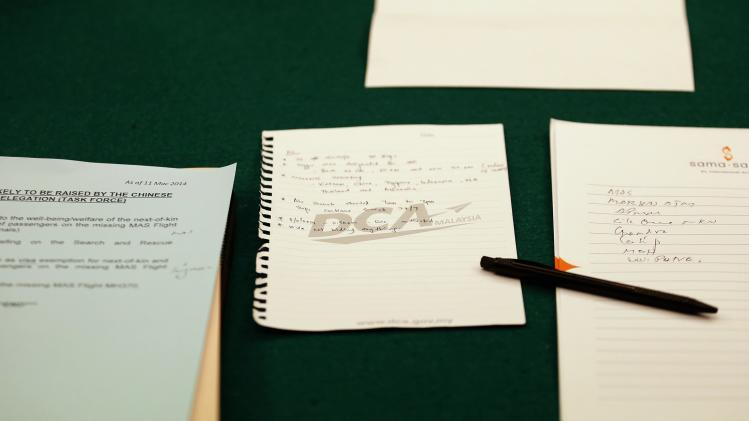 Notes are seen on the table where Malaysia's DCA officials were seated, during their meeting with a group sent by the Chinese government after the disappearance of Malaysia Airlines flight MH370, at Kuala Lumpur International Airport