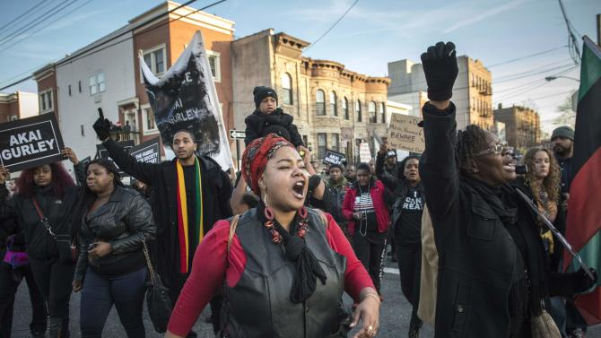 Protesters, demanding justice for Akai Gurley, march towards New York Police Department's (NYPD) 75th Precinct from the site of his shooting death in Brooklyn, New York