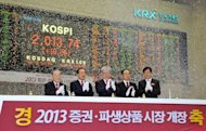 <p>South Korea's Financial Services Commission chairman Kim Seok-Dong (C) and officers celebrate the New Year opening of the stock market at the Korea Exchange in Seoul, on January 2, 2013. The benchmark Korea Composite Stock Price Index (KOSPI) gained 15.5 points, or 0.78 percent, to 2,012.55 in the first 15 minutes of trading.</p>