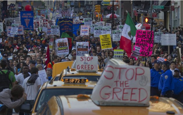 Thousands of demonstrators participate in the May Day march through downtown Manhattan, New York