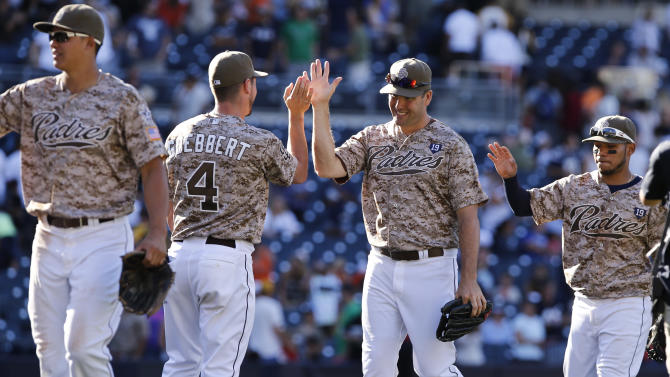 San Diego Padres celebrate an 8-2 win over the San Francisco Giants in a baseball game Sunday, Sept. 21, 2014, in San Diego. (AP Photo/Don Boomer)