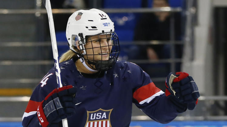 Brianna Decker of the United States celebrates her goal against Sweden during the third period of the 2014 Winter Olympics women's semifinal ice hockey game at Shayba Arena, Monday, Feb. 17, 2014, in Sochi, Russia. (AP Photo/Petr David Josek)