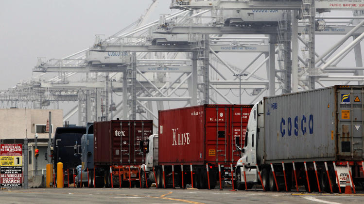 Trucks wait in long lines to load at the Port of Long Beach, Calif. on Tuesday, December 4, 2012. Los Angeles Mayor Antonio Villaraigosa says both sides in a strike at the twin ports of Los Angeles and Long Beach have agreed to federal mediation. However, the union representing clerical workers says the strike now in its eighth day will continue. Clerical workers are striking 10 terminals at the nation's busiest port complex and dockworkers won't cross picket lines.  (AP Photo/Nick Ut)
