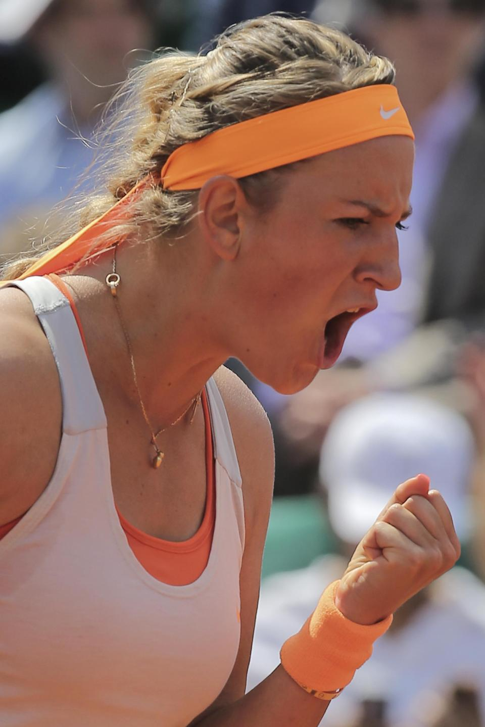 Victoria Azarenka of Belarus celebrates scoring against Russia's Maria Kirilenko in their quarterfinal match at the French Open tennis tournament, at Roland Garros stadium in Paris, Wednesday June 5, 2013. (AP Photo/Michel Euler)
