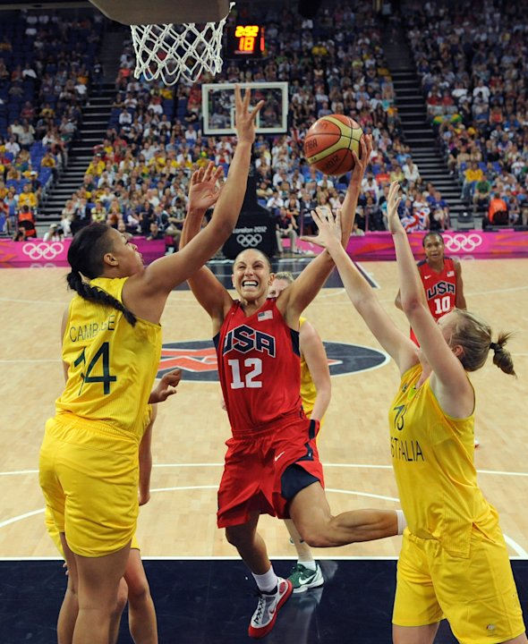 Australia's center Elizabeth Cambage, left, and forward Rachel Jarry, right, challenge United States' guard Diana Taurasi during their semifinal women's basketball game at the 2012 Summer Olympics on
