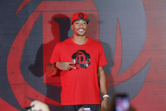 NBA star Rose poses for photographers after his news conference in Manila