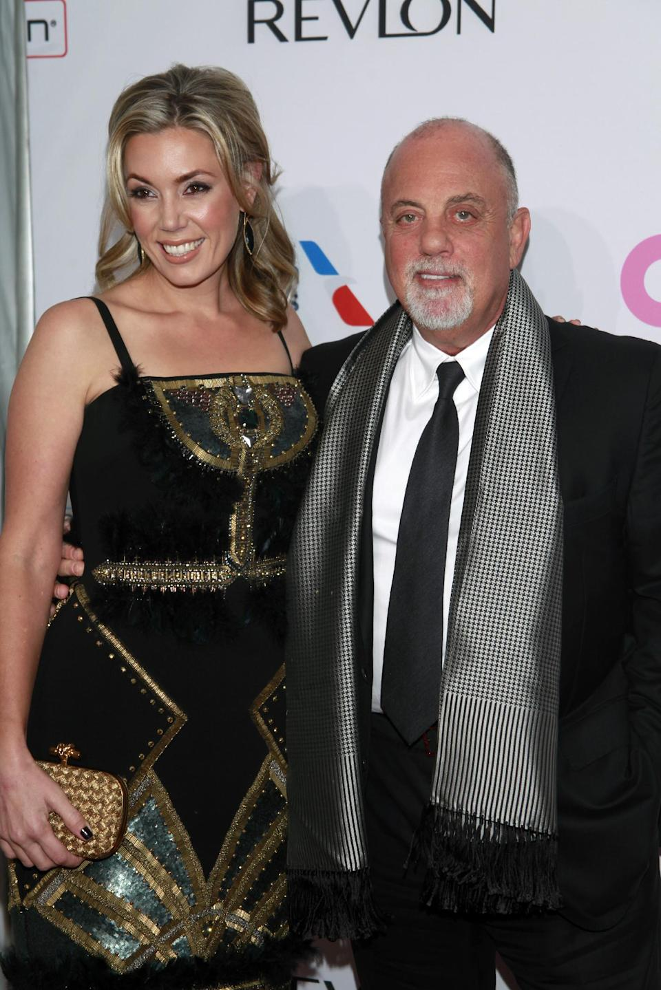 "Alexis Roderick and Billy Joel arrive at the Elton John AIDS Foundation's 12th Annual ""An Enduring Vision"" benefit gala at Cipriani Wall Street on Tuesday, Oct. 15, 2013 in New York. (Photo by Carlo Allegri/Invision/AP)"