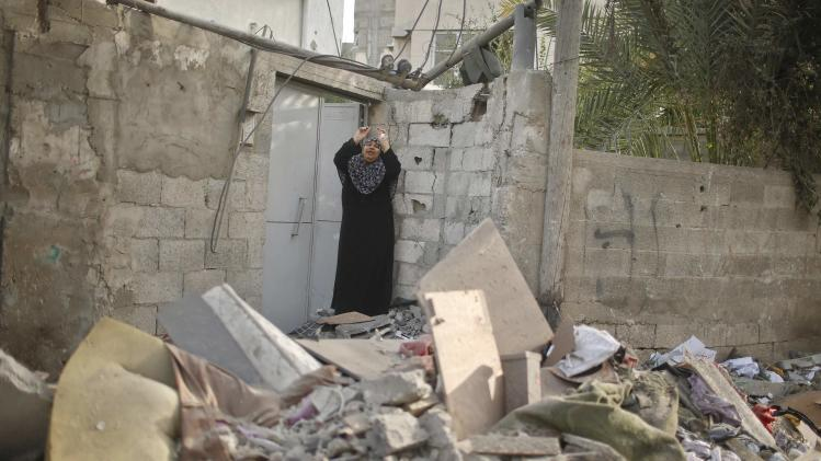 Palestinian woman reacts after what police said was an Israeli air strike that destroyed a neighbouring house in the northern Gaza Strip