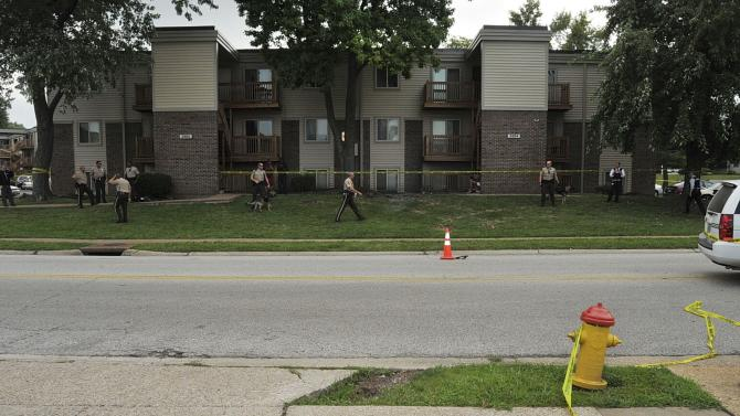 St. Louis County Prosecutor's Office evidence photo shows police officers investigating the scene of the August 9 Ferguson Police shooting of Michael Brown in Ferguson