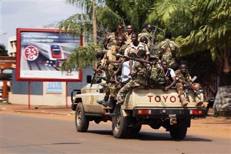 Seleka soldiers drive on a street during fighting in Bangui
