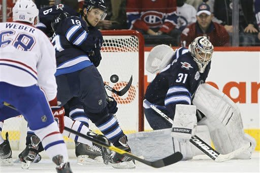 Wheeler scores 2 in Jets' 4-0 win over Canadiens