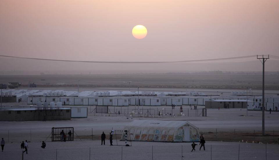 Syrian refugee youth play soccer at Zaatari Syrian refugee camp, near the Syrian border in Mafraq, Jordan, Tuesday, Dec. 25, 2012. (AP Photo/Mohammad Hannon)