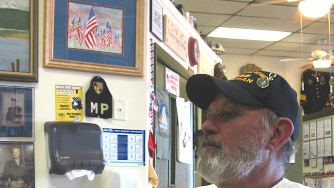 in this Dec. 17, 2013 photo, Kris Tourtellotte of Little River, S.C., founder of the nonprofit Veterans Welcome Home and Resource Center, sits in the Veterans Cafe in Myrtle Beach, S.C. In the four years the cafe has been open it has become a combination of an eatery, a military museum and place to hang out for those who served the nation in the military. (AP Photo/Bruce Smith)
