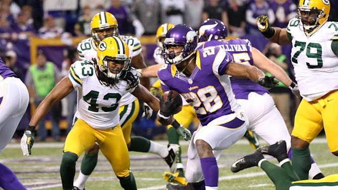 Minnesota Vikings running back Adrian Peterson (28) runs from Green Bay Packers free safety M.D. Jennings (43) during a seven-yard touchdown run in the first half of an NFL football game Sunday, Dec. 30, 2012, in Minneapolis. (AP Photo/Jim Mone)