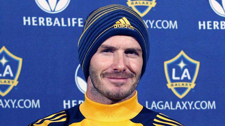 Los Angeles Galaxy's David Beckham, of England, smiles as he meets with reporters during a news conference in Carson, Calif., Tuesday, Nov. 20, 2012.  Beckham will play his final soccer  game for the Galaxy in the MLS Cup next month. (AP Photo/Alex Gallardo)