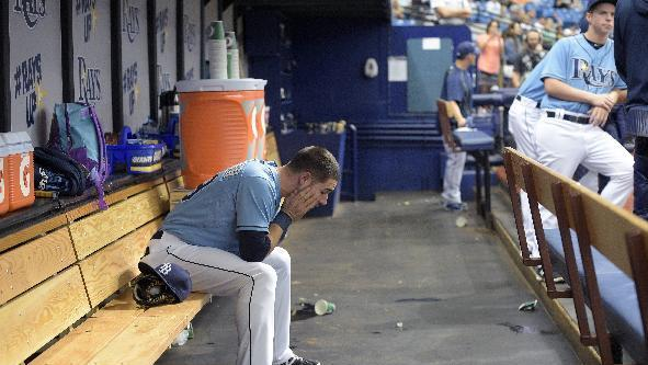 Tampa Bay Rays Kevin Kiermaier, left, sits in the dugout before a baseball game against the Toronto Blue Jays in St. Petersburg, Fla., Sunday, April 26, 2015.(AP Photo/Phelan M. Ebenhack)