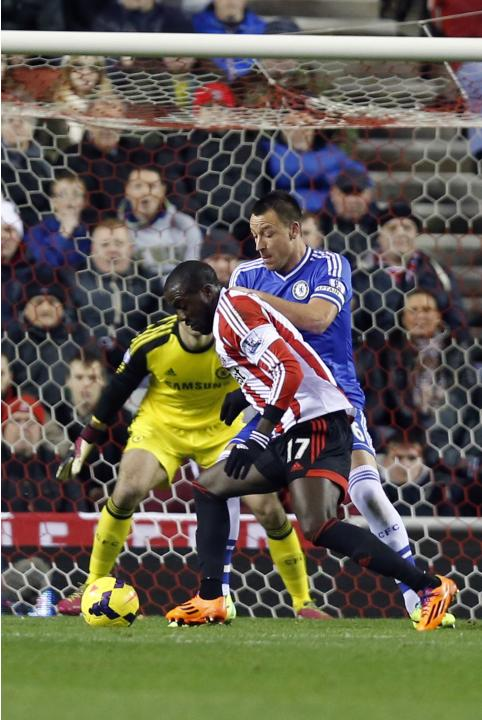 Sunderland's Altidore shoots past Chelsea's Terry to score during their English Premier League match in Sunderland