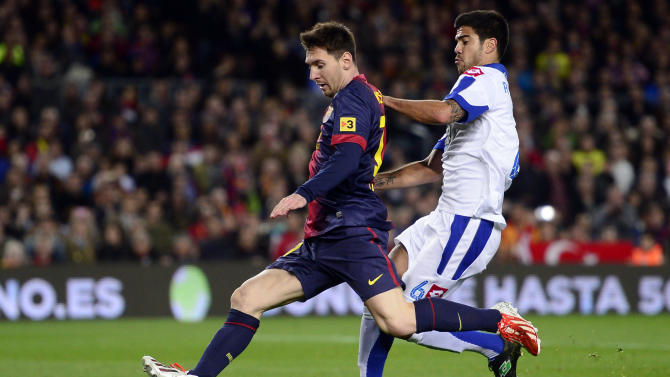 FC Barcelona's Lionel Messi, from Argentina, left, duels for the ball against Deportivo Coruna's Aythami Artiles during a Spanish La Liga soccer match at the Camp Nou stadium in Barcelona, Spain, Saturday, March 9, 2013. (AP Photo/Manu Fernandez)