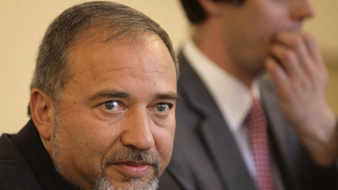 FILE - In this Thursday, Oct. 27, 2011 file photo, Israel's Foreign Minister Avigdor Lieberman talks with members of the Bosnian Presidency during meeting  in Sarajevo.  Israel's powerful foreign minister was charged Thursday with breach of trust, but escaped more serious charges in a fraud and money-laundering case that could jeopardize his political career and upend the Israeli political system just a month before parliamentary elections. The decision by Israel's attorney general capped an investigation into Foreign Minister Avigdor Lieberman that stretched back more than a decade. Lieberman, a close ally of Prime Minister Benjamin Netanyahu, immediately came under heavy pressure to resign. (AP Photo/Amel Emric, File)