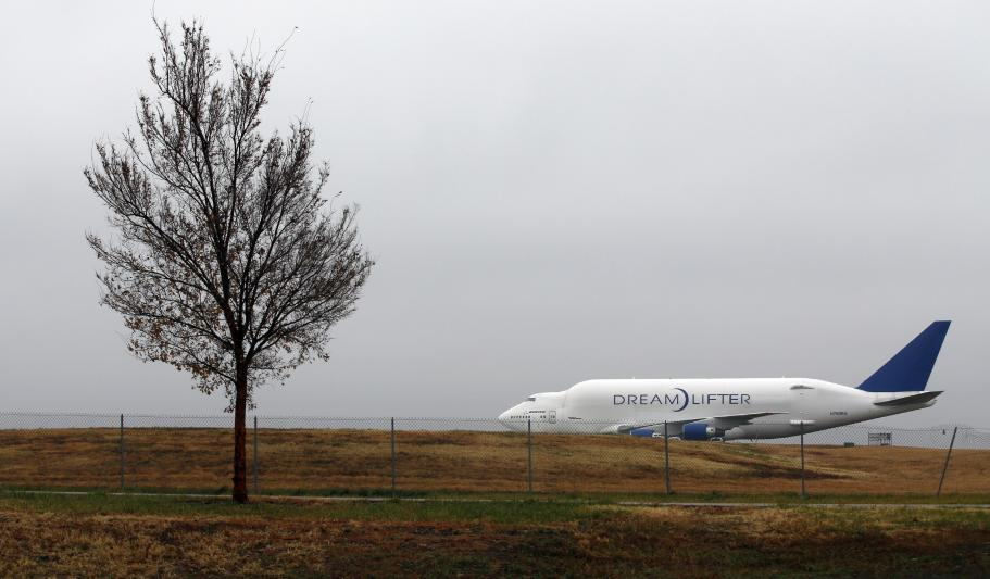 A Boeing 747 Dreamlifter sits on a runway Thursday, Nov. 21, 2013, the day after it mistakenly landed at Col. James Jabara Airport in Wichita, Kan. The jet landed Wednesday evening at the airport, about 8 miles (13 kilometers) north of its intended destination, the McConnell Air Force Base. (AP Photo/The Wichita Eagle, Jaime Green) LOCAL TV OUT; MAGS OUT; LOCAL RADIO OUT; LOCAL INTERNET OUT