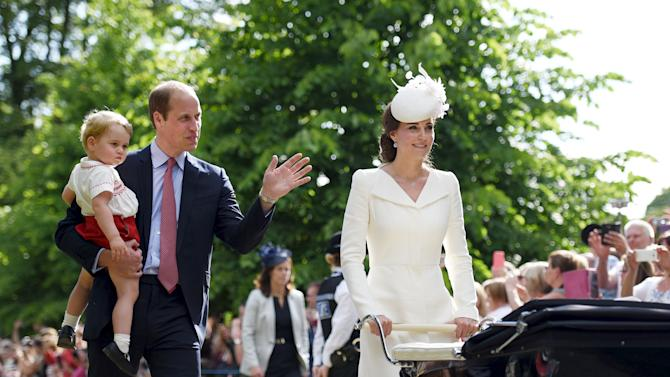 The Duke and Duchess of Cambridge walk past the crowds at the Church of St Mary Magdalene on the Sandringham Estate with their son Prince George and daughter Princess Charlotte, after her christening