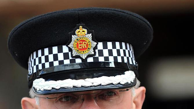 Greater Manchester Police Assistant Chief Constable Steve Heywood addresses the media following a trial at Liverpool Crown Court where nine men were found guilty of participating in a child sex ring, Liverpool, England, Tuesday, May 8, 2012. Nine men of Pakistani and Afghan descent were convicted Tuesday for participating in a child sex ring in a case that touched off deep sensitivities about race in Britain and galvanized the far right. (AP Photo/PA, Peter Byrne) UNITED KINGDOM OUT, NO SALES, NO ARCHIVE