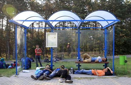 Migrants in Hungary seek traffickers on trip 'from death to death'