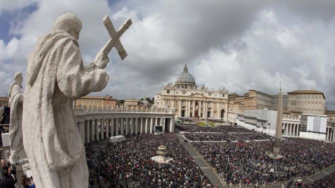 Pope Francis arrives to lead a open-air easter Mass  in St. Peter's Square at the Vatican, Sunday, March 31, 2013. Pope Francis is celebrating his first Easter Sunday Mass as pontiff in St. Peter's Square, which is packed by joyous pilgrims, tourists and Romans. (AP Photo/Alessandra Tarantino)