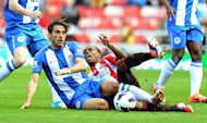 Wigan&#39;s Jordi Gomez, left, was sent off in the second half