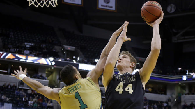 Purdue center Isaac Haas (44) shoots over Notre Dame forward Austin Torres (1) in the second half of an NCAA college basketball game in Indianapolis, Saturday, Dec. 20, 2014. Notre Dame won 94-63. (AP Photo/Michael Conroy)