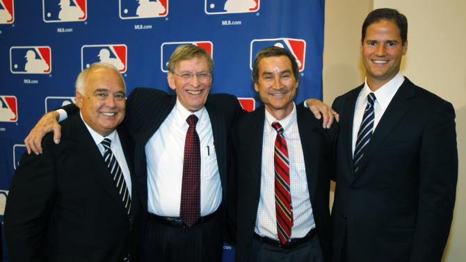 Major League Baseball Commissioner Bud Selig, second from left, joins members of a group approved to buy the San Diego Padres, from left, Ron Fowler, Peter Seidler and Kevin O'Malley after a meeting of baseball owners in Denver on Thursday, Aug. 16, 2012. Fowler, the chief executive of Liquid Investments, will become the controlling owner of the franchise if the purchase price of around $800 million is accepted by current Padres owner John Moores. (AP Photo/David Zalubowski)