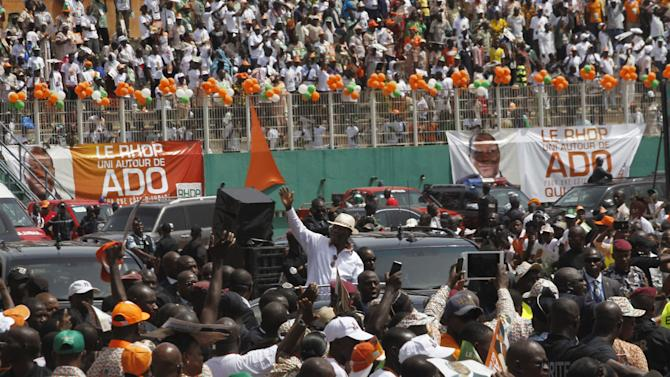 Ivory Coast's President Ouattara waves as he arrives for his investiture as the presidential candidate of the Rally of Houphouetists for Democracy and Peace political coalition in Abidjan