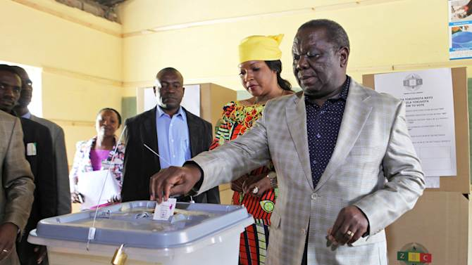 Zimbabwean Prime Minister Morgan Tsvangirai casts his vote during the country's referendum in Chitungwiza, about 30 Kilometers (20 miles) east of Harare, Zimbabwe, Saturday, March 16, 2013. Zimbabweans began casting ballots in a one-day referendum on a new constitution that all main political parties have backed, urging their supporters to vote 'Yes' to accept the 170-page draft document. (AP Photo/Tsvangirayi Mukwazhi)