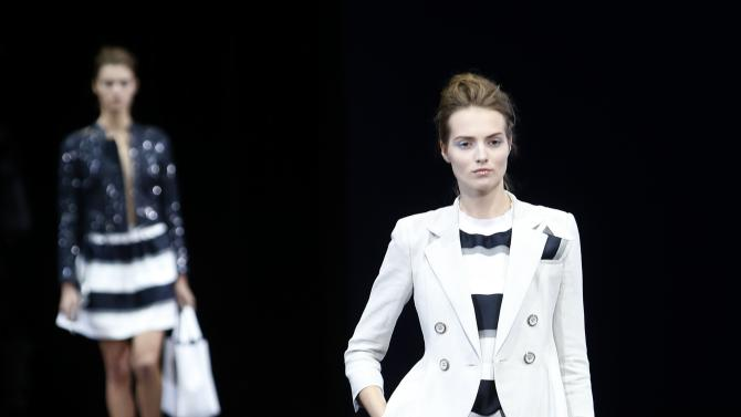 A model presents a creation from Emporio Armani Spring/Summer 2015 collection during Milan Fashion Week