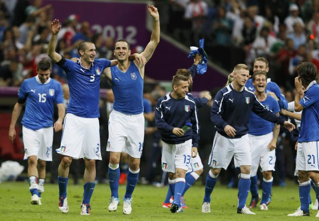 Italy's players celebrate qualifying for the final at the end of their Euro 2012 semi-final soccer match against Germany in Warsaw