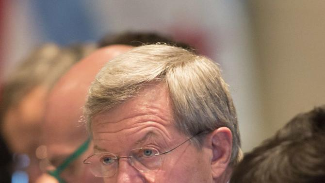 U.S. Ambassador to China Max Baucus listens during opening remarks at the U.S.-China Joint Commission on Commerce and Trade event in Chicago
