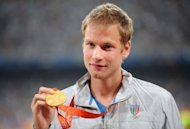 Italy's Alex Schwazer posing with his gold medal on the podium of the men's 50 km walk of the 2008 Beijing Olympic Games. Schwazer admitted doping on Monday and said his career was over after he was withdrawn from the Olympics for failing a drugs test