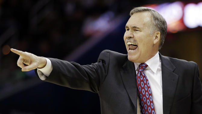 Los Angeles Lakers head coach Mike D'Antoni yells at his team in the fourth quarter of an NBA basketball game against the Cleveland Cavaliers, Tuesday, Dec. 11, 2012, in Cleveland. The Cavaliers won 100-94. (AP Photo/Mark Duncan)