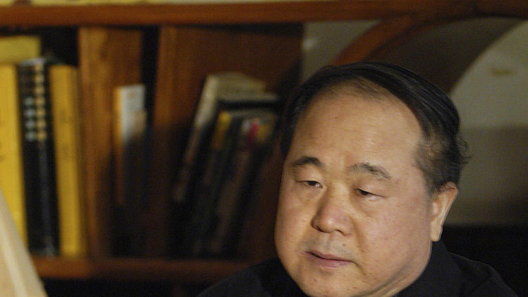 In this photo taken Tuesday Dec. 27, 2005, Chinese writer Mo Yan listens during an interview in Beijing. Mo won the Nobel Prize in literature on Thursday, Oct. 11, 2012. (AP Photo) CHINA OUT