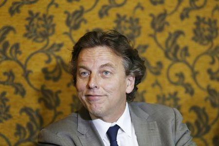 Dutch Foreign Minister Bert Koenders reacts during a news conference in Havana