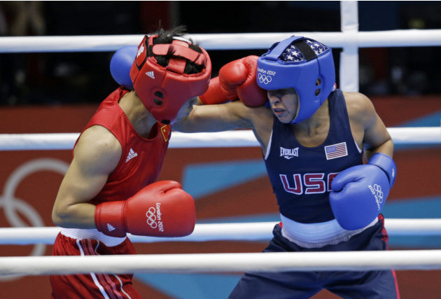 China's Ren Cancan, left, fights Marlen Esparza, of the United States during their women's semifinal flyweight 51-kg boxing match at the 2012 Summer Olympics, Wednesday, Aug. 8, 2012, in London. (AP P