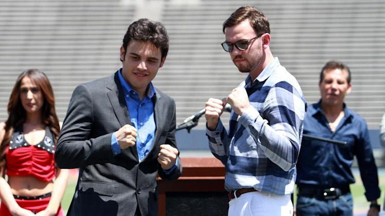 "FILE - In this April 24, 2012, file photo Julio Cesar Chavez Jr. left, and his opponent Andy Lee pose for pictures during a news conference at Sun Bowl Stadium in El Paso, Texas. A federal risk assessment of the West Texas boxing match between the two that had been cancelled, predicted it would draw leaders from two rival drug cartels, but noted the cartels had declared the event a ""neutral zone,"" a law enforcement official told The Associated Press on Friday, April 27, 2012. (AP Photo/El Paso Times, Rudy Guteirrez, File)"
